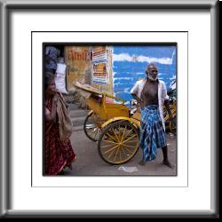 older man,India woman, rickshaw, pedicab